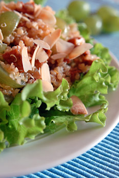 Quinoa salad with smoked tofu, grapes and almonds