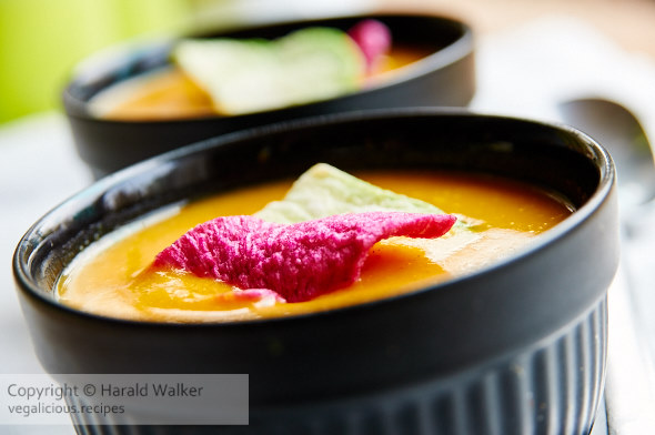 Spicy Pumpkin Soup, garnished with radish chips.