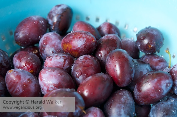 Plums in a colander