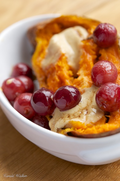 Roasted Grape Filled Sweet Potatoes with Vegan Cheese Sauce and Maple Syrup