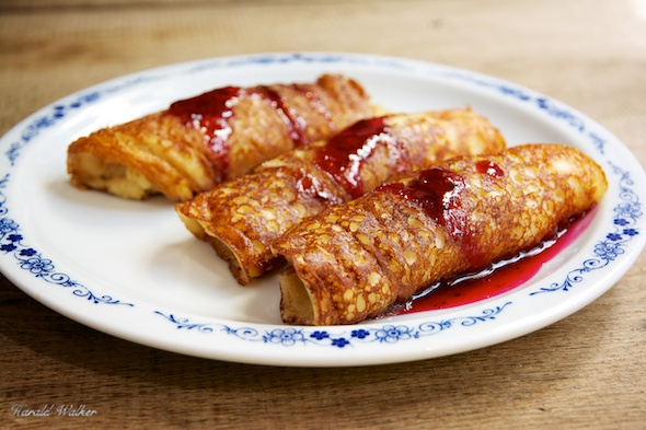 Vegan Blintzes with Mixed Berry Sauce - Click here to license this image from Stocksy