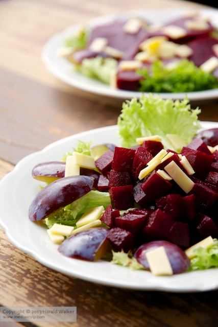 Beet and Plum Salad with Vegan Cheese - Click here to license this image