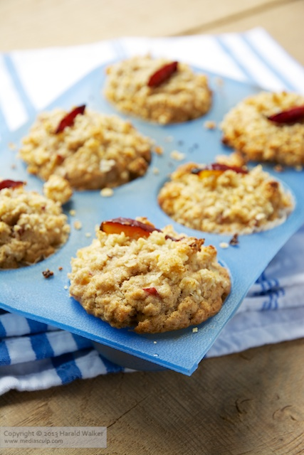 Streusel Topped Almond Plum Muffins - Click here to license this image from Stocksy