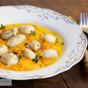 Celery root gnocchi with apple carrot sauce - Click here to license this photo from Stocksy
