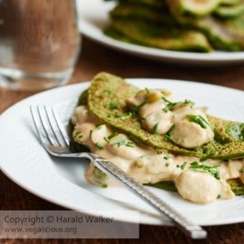 Vegan spinach pancakes with creamy fava bean sauce