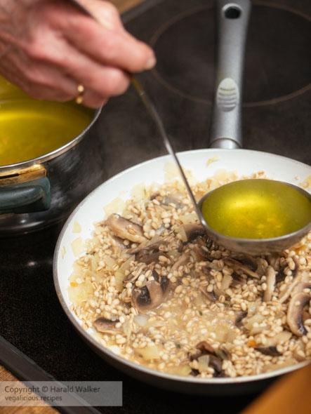 Making barley mushroom risotto